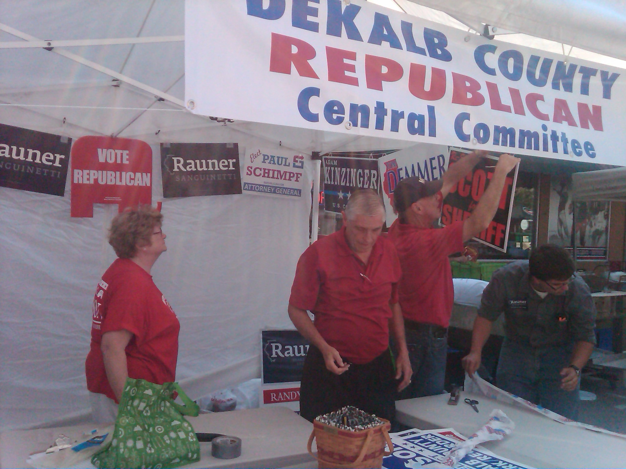 Sharon Holmes and Rep. Pritchard setting up Cornfest Booth